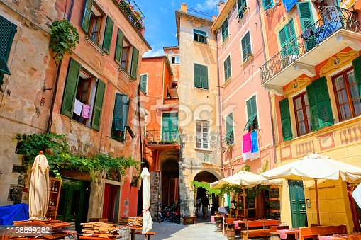 Colorful square with restaurant tables in the Cinque Terre village of Monterosso, Italy