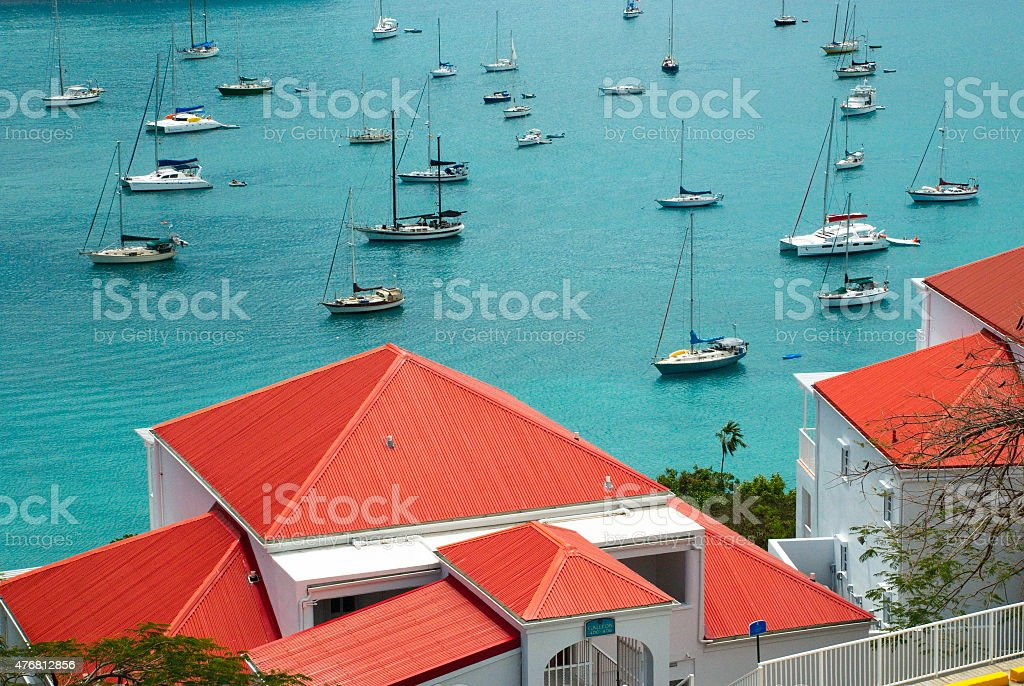Colorful St. Croix, US Virgin Islands Red roof tops overlooking the brilliant turquoise blue Caribbean bay with boats in downtown St. Croix, US Virgin Islands. Architecture Stock Photo