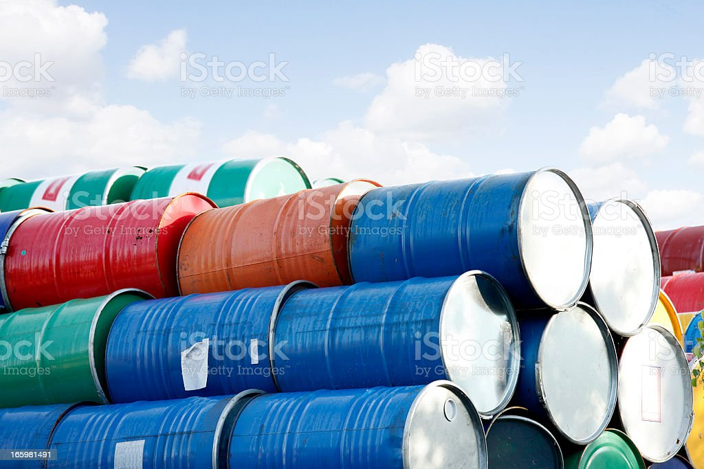 colorful stacked Barrels in front of the sky stock photo