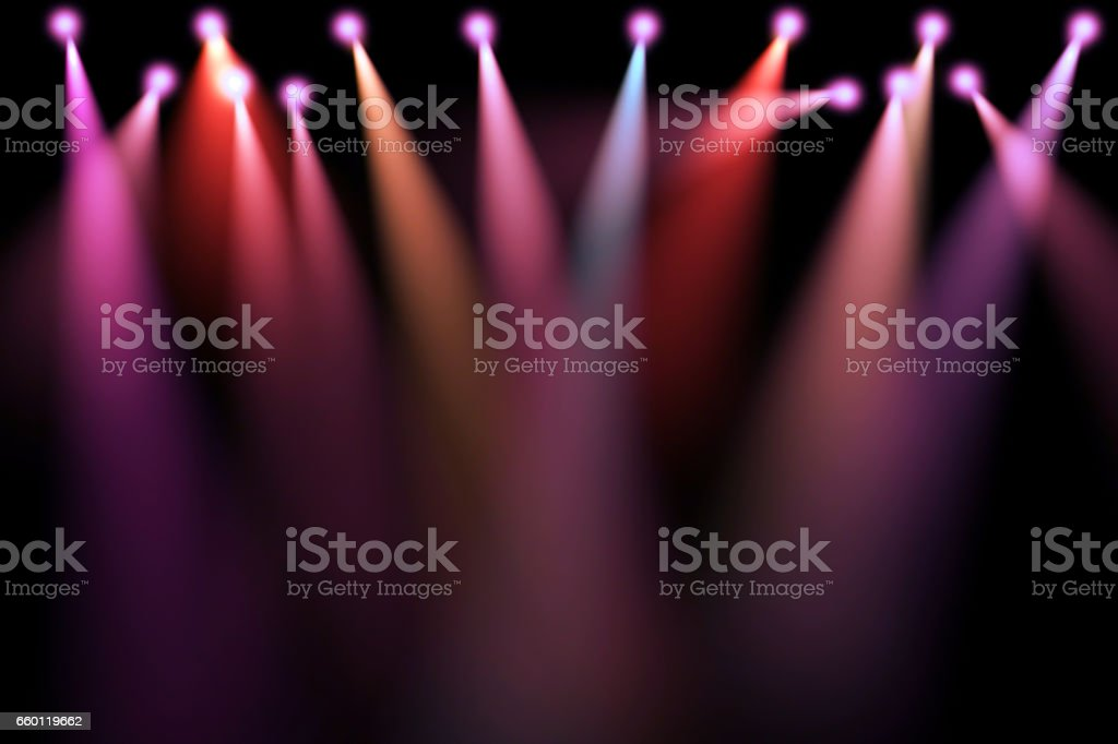 colorful stage lights, projectors in the dark, purple,red,blue soft light spotlight strike stock photo