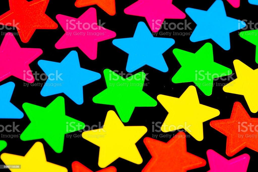 Colorido estrelas em preto foto royalty-free