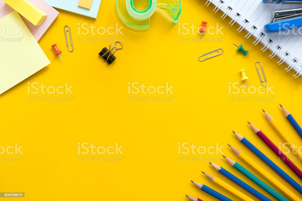 Colorful stationery on yellow background stock photo