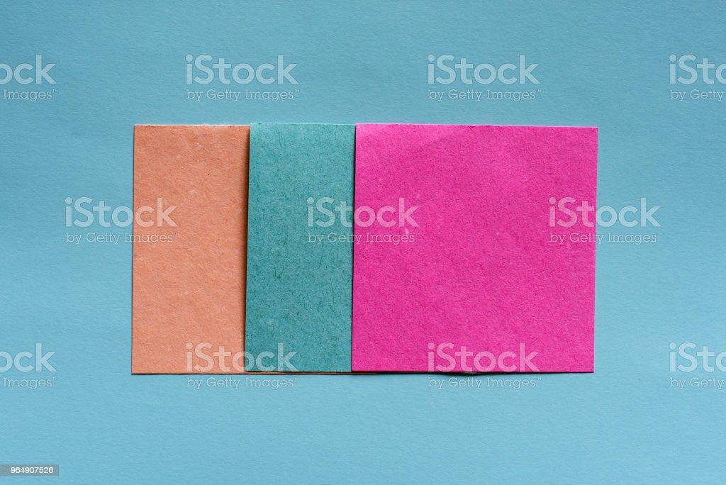 colorful sticky notes on light blue background, royalty-free stock photo