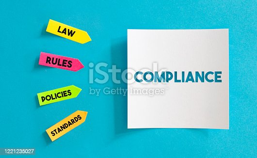 istock Colorful Sticky Notes Papers And White Paper with Compliance Message Over the Blue Paper. Horizontal composition with copy space. 1221235027