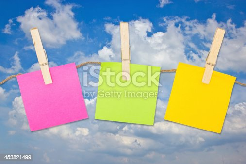 istock Colorful sticky notes with clothespins. 453821499