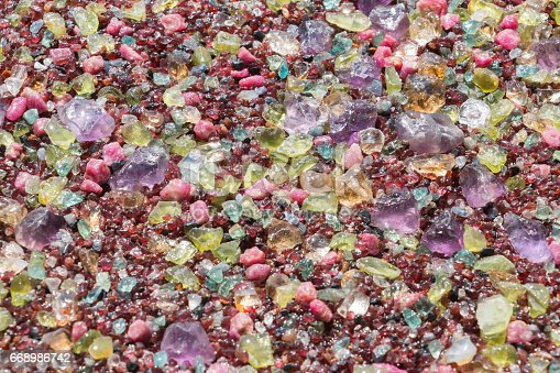 istock Colorful stones background - pile of semi precious jewelery stones 668986742