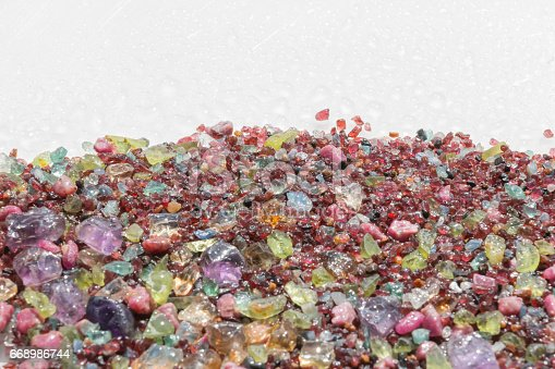 istock Colorful stones background - pile of semi precious jewelery stones 668986744