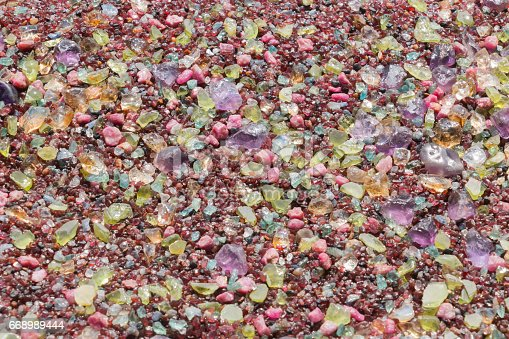 istock Colorful stones background - pile of semi precious jewelery stones 668989444