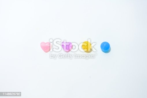 Colorful stones in heart shape on the white background