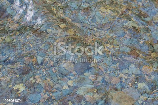 Colorful stones in stream water - abstract theme