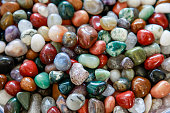 Many colorful stones in a heap. Special stones on a market.