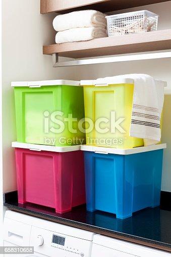 Colorful storage boxes on shelf