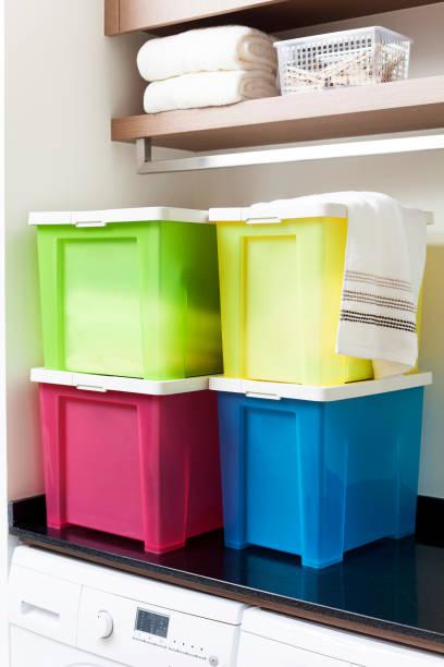 Colorful storage boxes on shelf – Foto