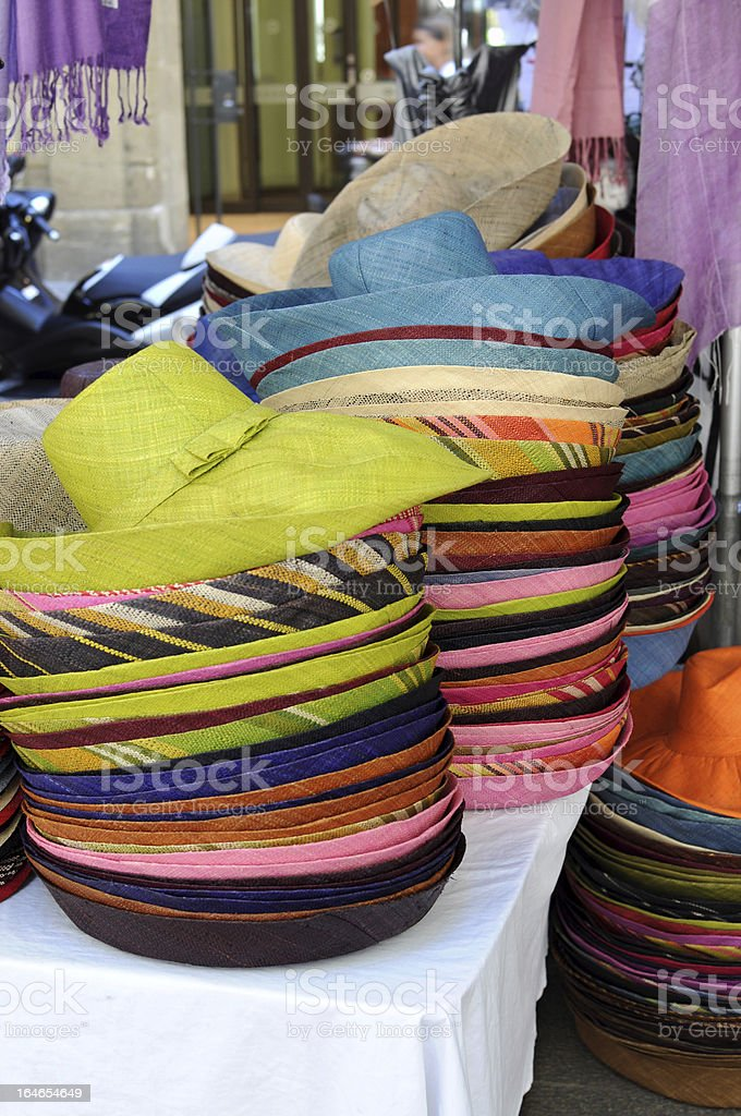 Colorful straw hats in market stall royalty-free stock photo
