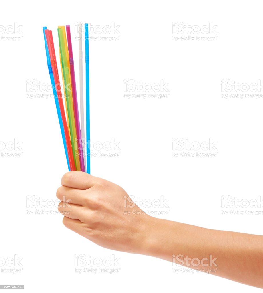 colorful straw in hand isolated on white background stock photo