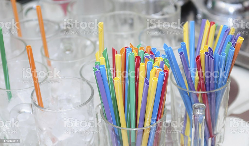 Colorful straws and blank glasses royalty-free stock photo