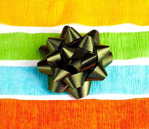 Colorful Streamers and a Green Ribbon Bow stock photo