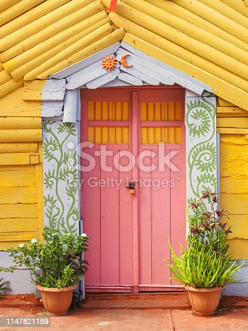 Colorful street front doors, Caribbean island of Isla Mujeres, Mexico.