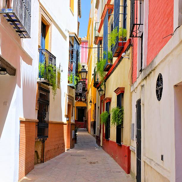 colorful street in the old town of sevilla, spain - andalousie photos et images de collection