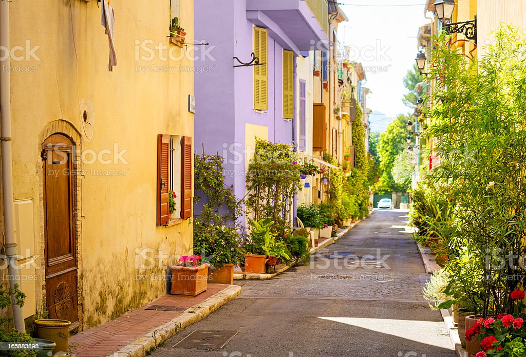 Colorful street in town in Provence, France stock photo