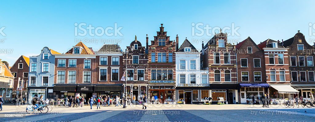 Colorful street view with houses and people in Delft, Holland stock photo