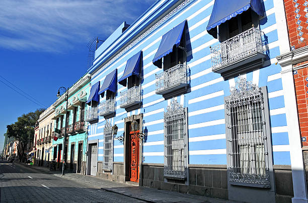 Colorful Streets of Puebla City, Mexico Puebla, Mexico - December 30, 2012: Characterized by its vibrantly colored buildings and narrow streets, Puebla is a popular spot for tourists, despite being built under multiple active volcanoes.  orizaba stock pictures, royalty-free photos & images