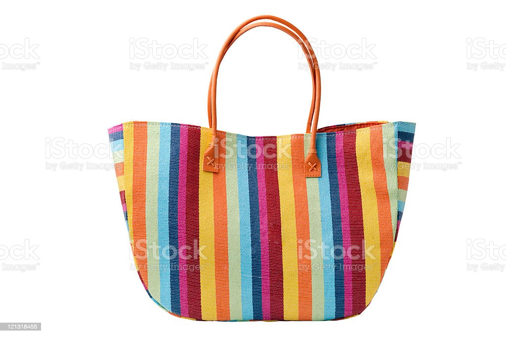 Colorful striped beach bag, isolated on a white background royalty-free stock photo