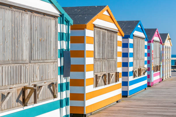 Colorful, striped beach Cabanas Beach cabanas in bright, bold colors taken in Hastings, UK beach hut stock pictures, royalty-free photos & images