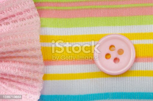 colorful striped fabric background with pink bud