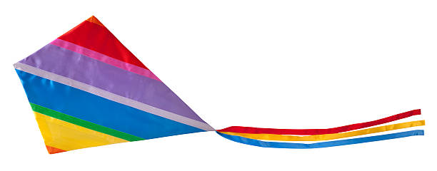 Colorful striped kite with long tail in motion stock photo