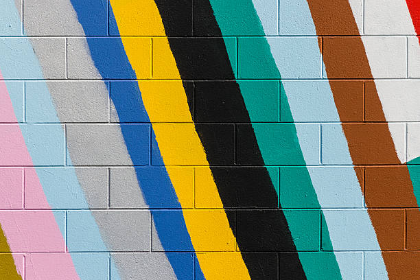 colorful stripes painted on wall colorful stripes painted on brick wall street art stock pictures, royalty-free photos & images