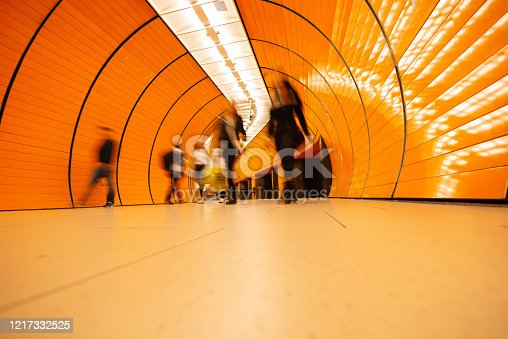 686251110 istock photo Colorful subway station in Munich Germany with walking people 1217332525