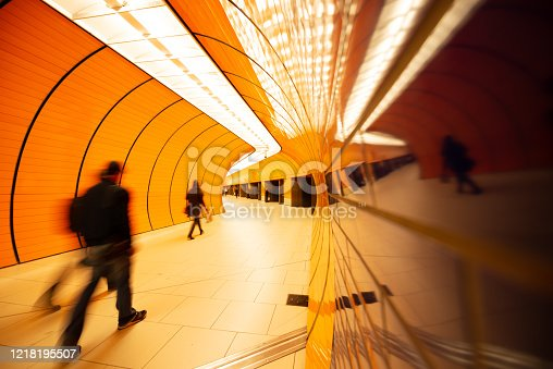 686251110 istock photo Colorful subway station in Munich Germany with walking people 1218195507