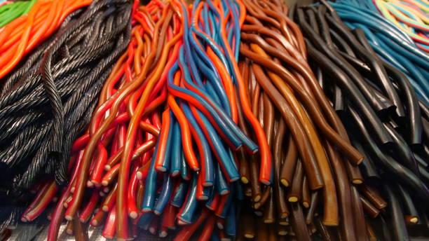 Colorful sugar cords and liquorice cords - 2 stock photo