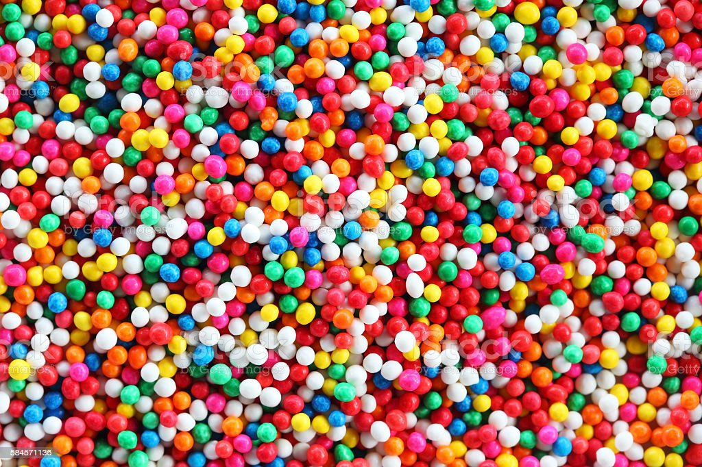 colorful sugar sprinkle background. stock photo