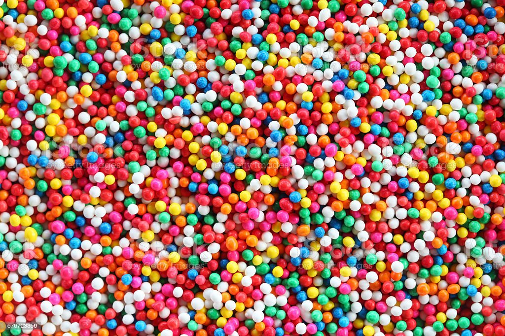 colorful sugar sprinkles background. stock photo