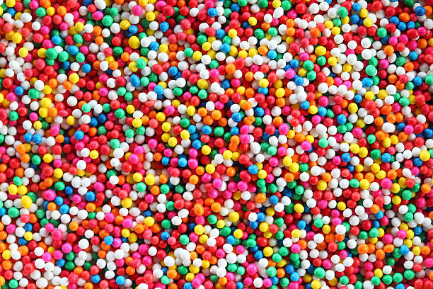 colorful sugar sprinkles background. - Photo