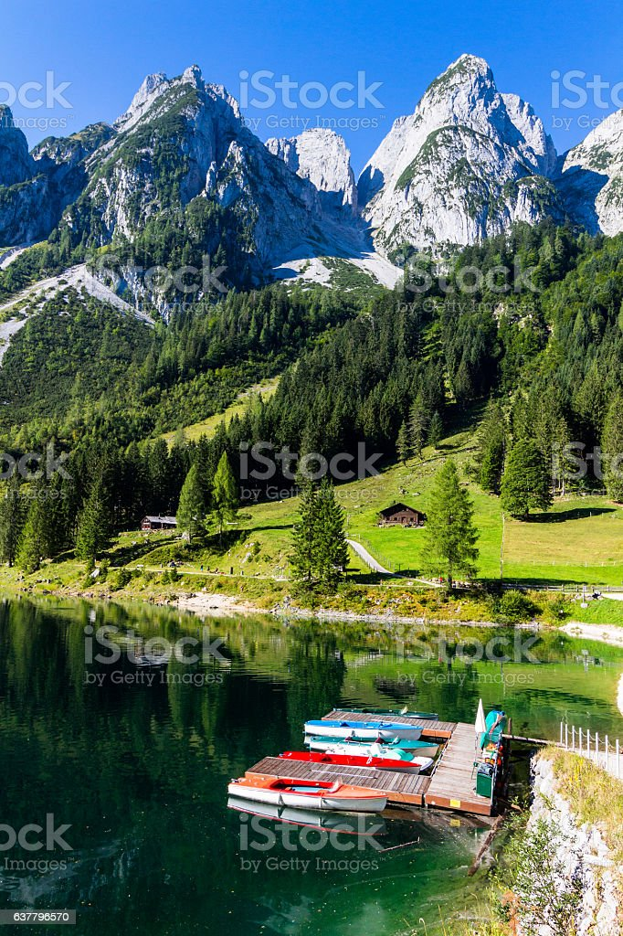 Colorful summer scenery with clear Gosausee mountain lake and boats stock photo