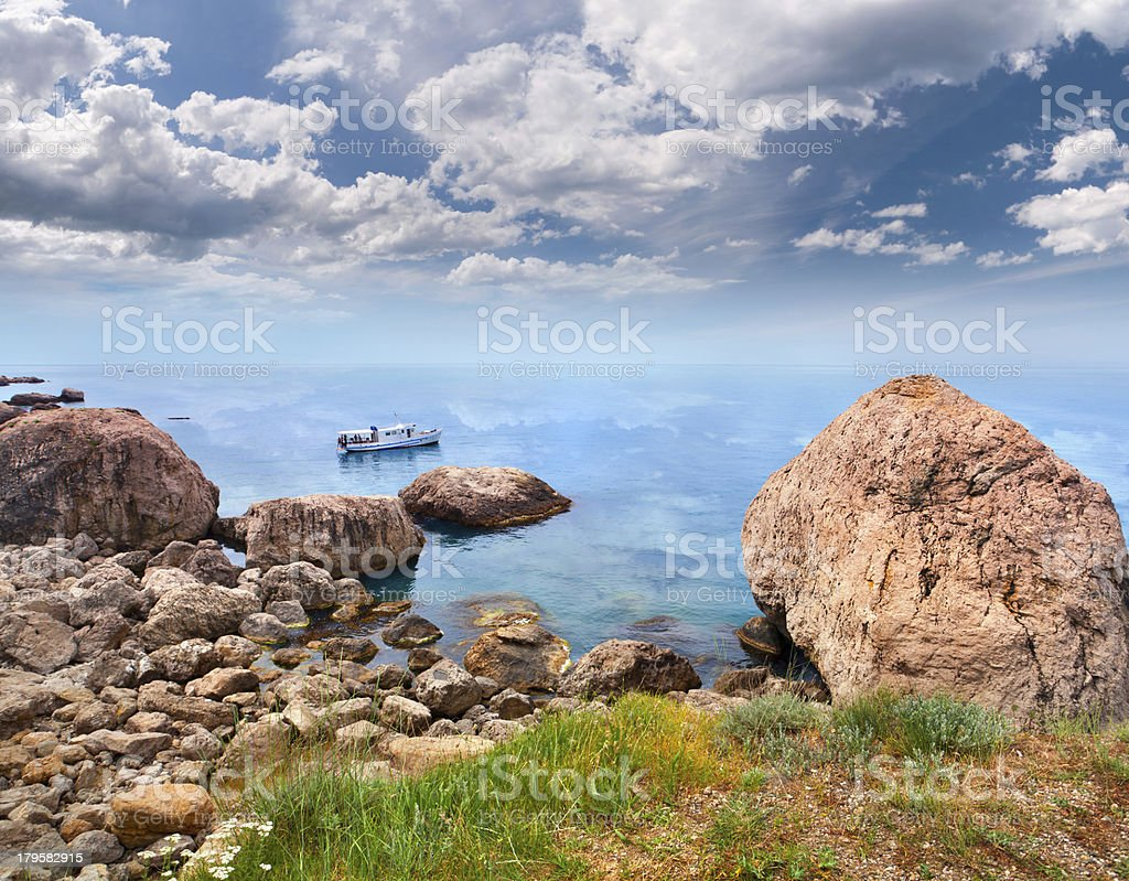 Colorful summer seascape with huge rock royalty-free stock photo