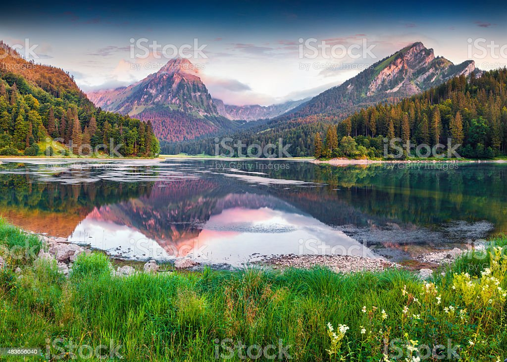 Colorful summer sunrise on the incredibly beautiful Swiss lake Obersee