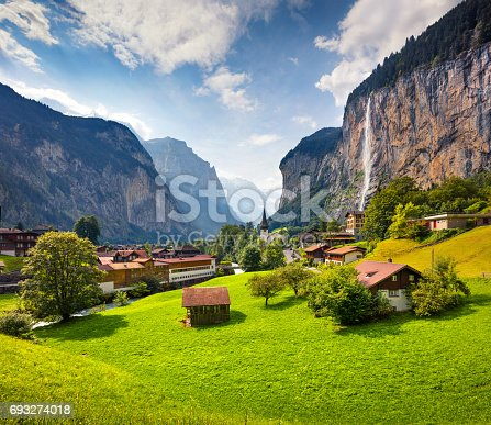 Colorful summer view of Lauterbrunnen village. Beautiful outdoor scene in Swiss Alps, Bernese Oberland in the canton of Bern, Switzerland, Europe. Artistic style post processed photo.