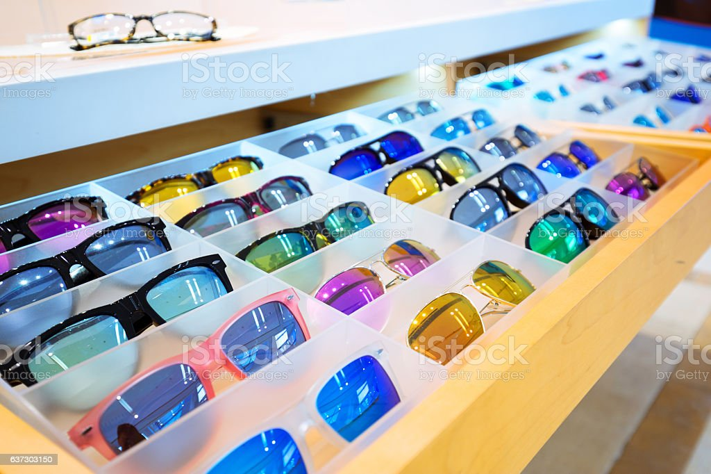 colorful sunglasses on wood shelf stock photo