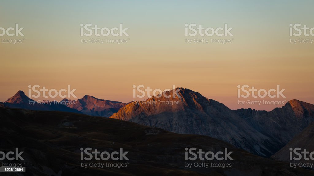 Colorful sunlight on the majestic mountain peaks and ridges of the Alps. stock photo
