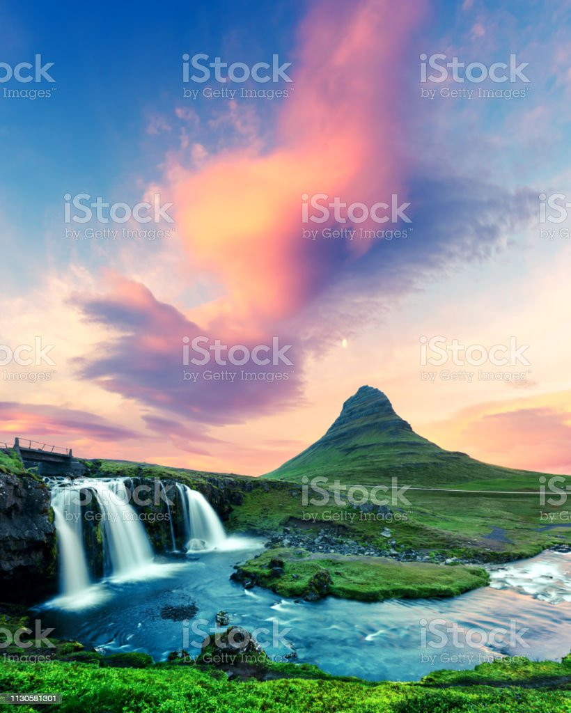 Colorful sunrise on Kirkjufellsfoss waterfall stock photo