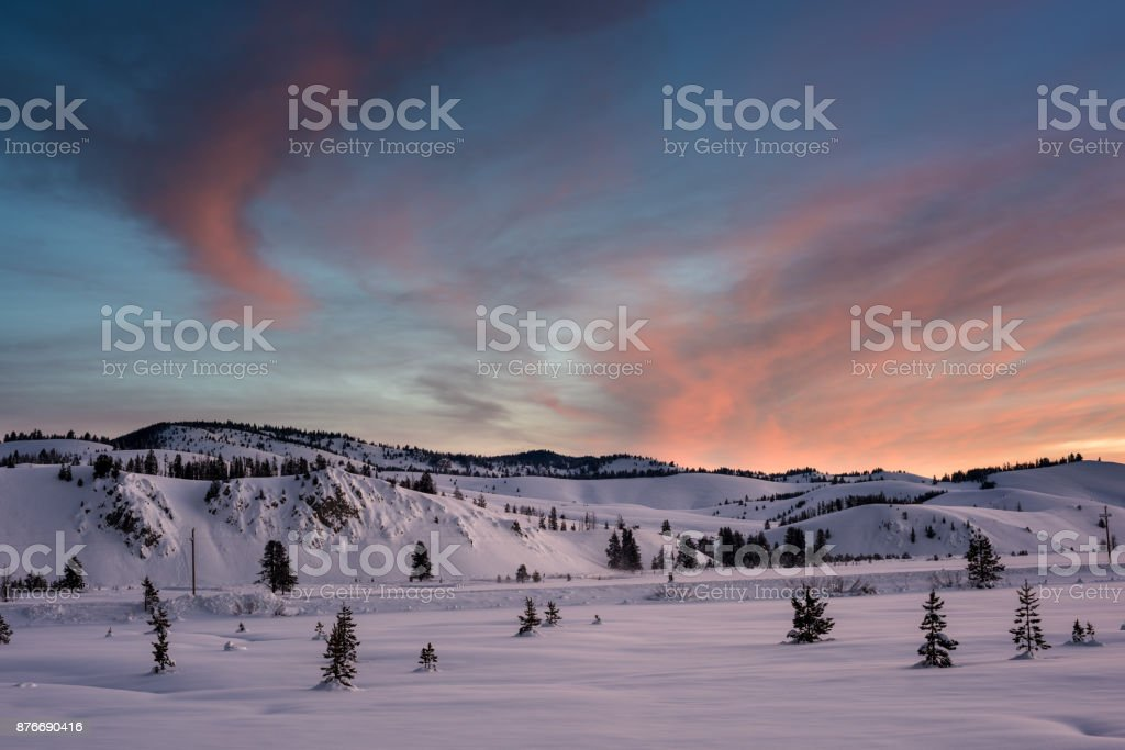 Colorful sunrise over a winter meadow in Idaho stock photo
