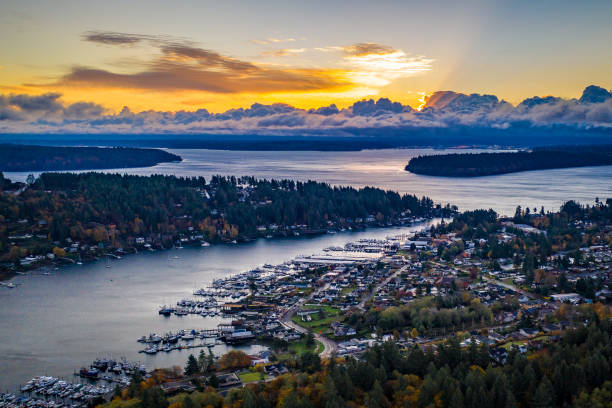 A Colorful Sunrise Over Gig Harbor Washington An aerial view of Gig Harbor and Tacoma Washington at sunrise puget sound stock pictures, royalty-free photos & images