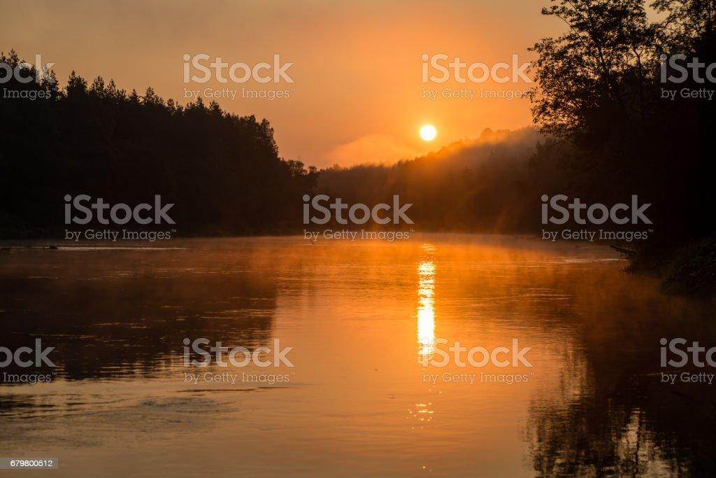colorful sunrise over the lake stock photo