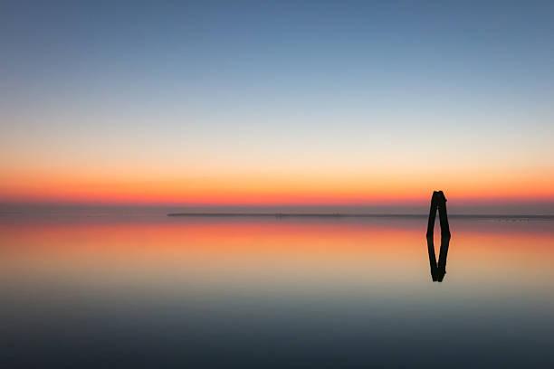 Colorful sunrise over the Venetian lagoon stock photo