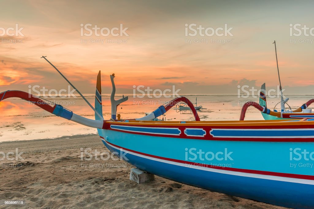 A colorful sunrise with a traditional indonesian fishing boat - Royalty-free Asia Stock Photo