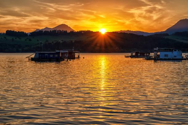 Colorful sunset  and reflection on water surface at lake Liptovska Mara, Slovakia. stock photo
